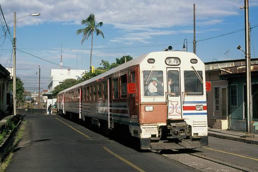 Apolo motor coach ex FEVE on street operation on the connecting line between Estación al Pacífico and Estación al Atlántico. In the background the station building of the Pacific station.