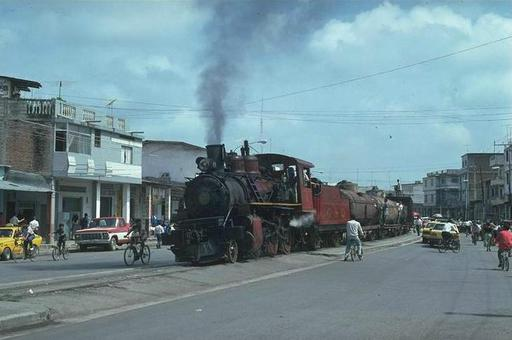 The Mixto  with lowland engine 11 crosses the city of Milagro on the way from Yaguachi to Bucay, Ecuador.