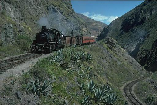 Mountain engine 58 has with a Mixto passed the lower setting-back track at the Devil's Nose and pushes the train uphill to the upper setting-back track, Ecuador.