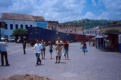 The cars disappear into the streets of Cachoeira, Brazil.